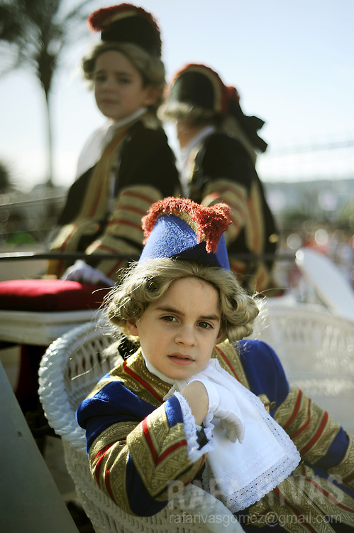 A child sits on a carriage as he takes part in San Sebastian's Tamborrada. Some thousands soldiers-clad children march and play drums, on January 20, 2010, during a parade to celebrate San Sebastian's day, the northern Spanish Basque city of San Sebastian's main feast. PHOTO / RAFA RIVAS