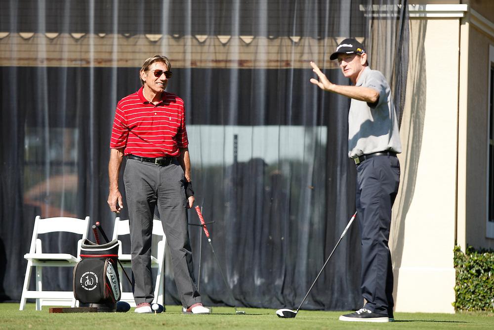 Hank Haney provides golf instruction to football legend Joe Namath for the Golf Channel.