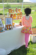 Elfe Hughes, of Roslindale, looks at honey from the Norfolk County Beekeepers at Powisett Farm's Annual  SpringFest, in Dover, May 18, 2014.<br /> Wicked Local staff photo / Kate Flock