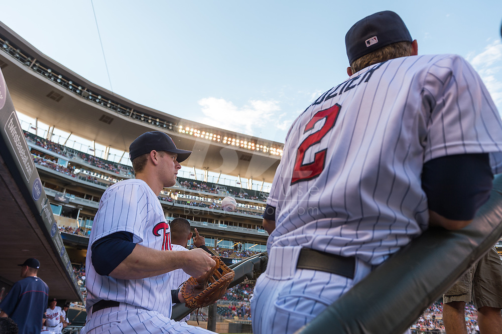 Justin Morneau #33 and Brian Dozier #2 of the Minnesota Twins look on during a game against the Kansas City Royals on June 27, 2013 at Target Field in Minneapolis, Minnesota.  The Twins defeated the Royals 3 to 1.  Photo by Ben Krause