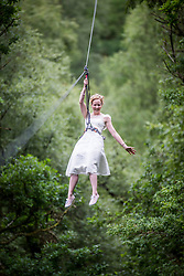 Martin Milner and Colette Gregory tying the knot in the trees at Go Ape Aberfoyle. Colette Gregory arriving of the first zip wire.