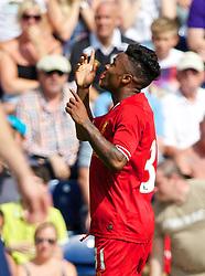 PRESTON, ENGLAND - Saturday, July 13, 2013: Liverpool's Raheem Sterling celebrates scoring the third goal against Preston North End during a preseason friendly match at Deepdale. (Pic by David Rawcliffe/Propaganda)
