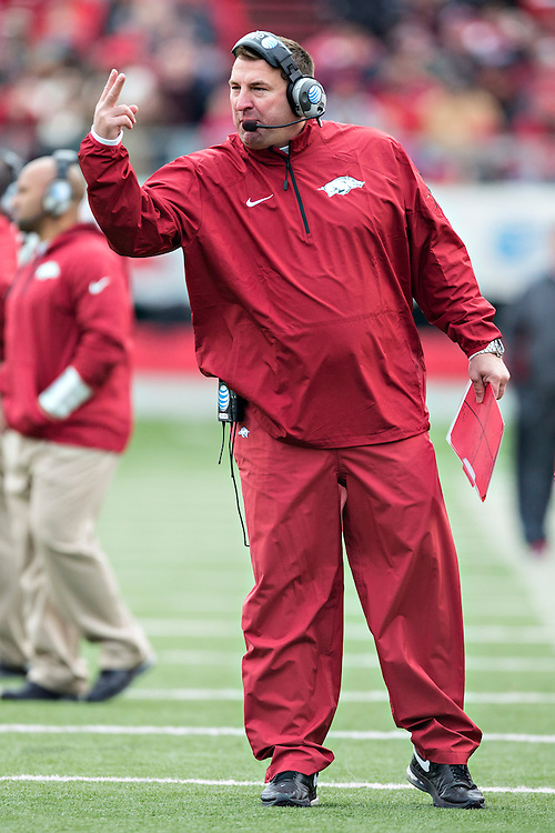 LITTLE ROCK, ARKANSAS - NOVEMBER 23:  Head Coach Bret Bielema of the Arkansas Razorbacks signals to his team during a game against the Mississippi State Bulldogs at War Memorial Stadium on November 23, 2013 in Little Rock, Arkansas.  The Bulldogs defeated the Razorbacks 24-17.  (Photo by Wesley Hitt/Getty Images) *** Local Caption *** Bret Bielema