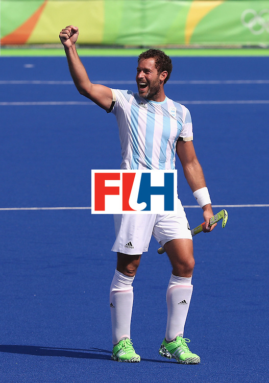 RIO DE JANEIRO, BRAZIL - AUGUST 16: Juan Gilardi of Argentina celebrates after their 5-2 victory during the Men's semi final hockey match between Argentina and Germany on Day 11 of the Rio 2016 Olympic Games held at the Olympic Hockey Centre on August 16, 2016 in Rio de Janeiro, Brazil.  (Photo by David Rogers/Getty Images)