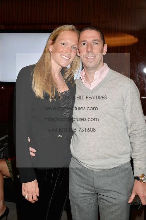 CHRISTIAN CANDY and his wife EMILY CROMPTON-CANDY at a private screening of The Anonymous People in aid of Action on Addiction held at The Bulgari Hotel, 171 Knightsbridge, London on 20th May 2015.