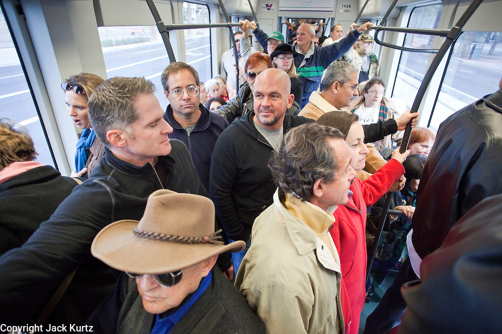 27 DECEMBER 2008 -- PHOENIX, AZ: AT 10:21AM The southbound trains into downtown Phoenix were packed Saturday morning. Metro Light Rail started running Saturday, Dec. 28. The light rail line is 20 miles long and cost $1.4 billion dollars. PHOTO BY JACK KURTZ