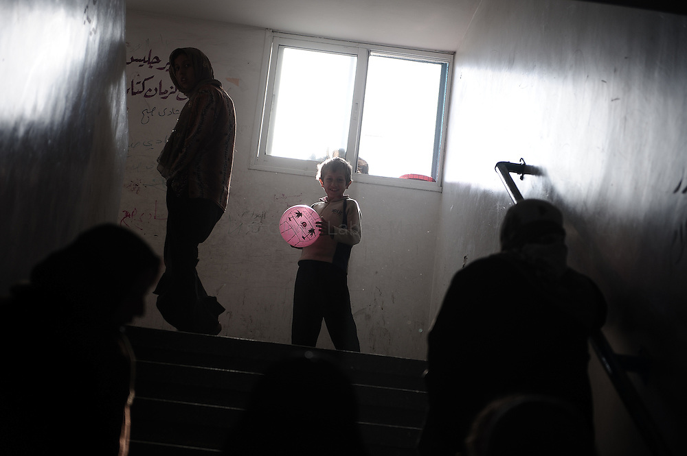 A Palestinian refugee boy plays with a ball at a school run by UNRWA, the UN agency for Palestinian refugees, in Gaza City on January 22, 2009. The United Nations urged Israel to reopen Gaza crossings as senior officials assessed war damage and the Jewish state warned it would strike again if Hamas rearms through smuggling tunnels.