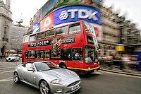 A London tour bus, outside of the Piccadilly Circus, London, England.