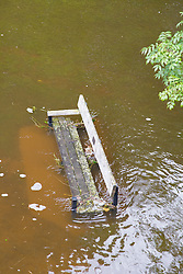 Park bench partially submerged under water after torrential rain caused flooding in Oxford and the Thames Valley area; July 2007,