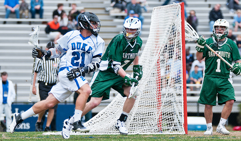March 20 2011:Duke attack Zach Howell (21) drives on goal guarded by Dartmouth defender Pat Flynn (7).