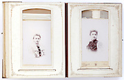 open vintage photo album from late 1800s with portraits