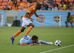 July 18, 2018 - Houston, TX, U.S. - HOUSTON, TX - JULY 18:  Houston Dynamo midfielder DaMarcus Beasley (7) hops over Sporting Kansas City forward Diego Rubio (11) to capture the ball during the US Open Cup Quarterfinal soccer match between Sporting KC and Houston Dynamo on July 18, 2018 at BBVA Compass Stadium in Houston, Texas. (Photo by Leslie Plaza Johnson/Icon Sportswire) (Credit Image: © Leslie Plaza Johnson/Icon SMI via ZUMA Press)