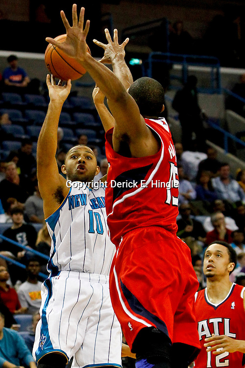 Jan 1, 2013; New Orleans, LA, USA; New Orleans Hornets shooting guard Eric Gordon (10) shoots over Atlanta Hawks center Al Horford (15) during the first quarter of a game at the New Orleans Arena. Mandatory Credit: Derick E. Hingle-USA TODAY Sports