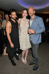 The UK Premier of Johnnie Walker Blue Label's 'Gentleman's Wager' - a short film starring Jude Law was held at The Bulgari Hotel & Residences, 171 Knightsbridge, London on 22nd July 2014.<br /> Picture Shows:-Left to right, NIK THAKKAR, COSIMA BELLAMACINA and ALASTAIR GUY.