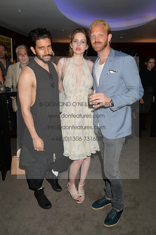 The UK Premier of Johnnie Walker Blue Label's 'Gentleman's Wager' - a short film starring Jude Law was held at The Bulgari Hotel &amp; Residences, 171 Knightsbridge, London on 22nd July 2014.<br /> Picture Shows:-Left to right, NIK THAKKAR, COSIMA BELLAMACINA and ALASTAIR GUY.