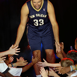 Aug 1, 2013; Metairie, LA, USA; New Orleans Pelicans forward Ryan Anderson (33) during a uniform unveiling at the team practice facility. Mandatory Credit: Derick E. Hingle-USA TODAY Sports