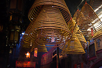 Spiral incense coils hang from the roof in Tin Hau temple, Hong Kong.