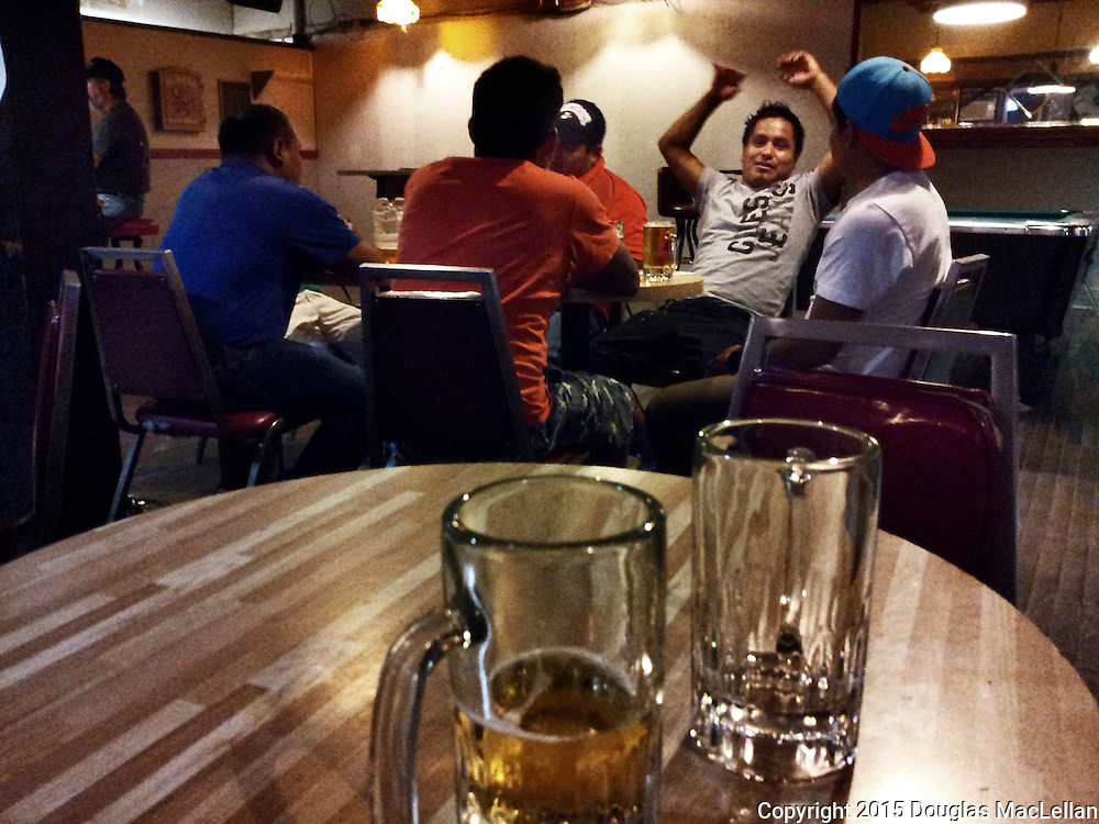 Five men, all temporary workers, relaxing in the International Hotel in Leamington, Ontario.