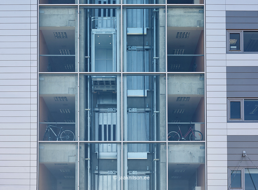 Transparent windows and elevator shaft in Estonia. Large modern building with glass exterior wall.