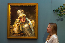 "© Licensed to London News Pictures. 31/05/2019. LONDON, UK. A staff member views ""Boyarina"" by Konstantin Egorovich Makovsky (Est. GBP 80,000-120,000) at a preview of works from the upcoming sale of Russian Pictures, Works of Art, Fabergé & Icons Sales at Sotheby's, New Bond Street, on 4 June 2019.  Photo credit: Stephen Chung/LNP"