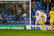 Luton Town forward Elliot Lee (10) shoots to goal during the EFL Sky Bet League 1 match between Oxford United and Luton Town at the Kassam Stadium, Oxford, England on 2 October 2018.