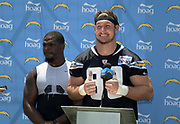 Jul 29, 2018; Costa Mesa, CA, USA; Los Angeles Chargers linebacker Denzel Perryman (left) and defensive end Joey Bosa (99) during training camp press conference at Jack R. Hammett Sports Complex.