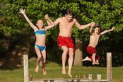 Family Jumping into Lake