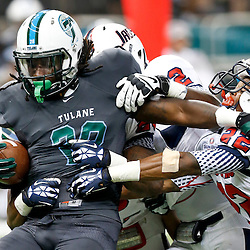 Sep 7, 2013; New Orleans, LA, USA; Tulane Green Wave running back Rob Kelly (28) is tackled by a group of South Alabama Jaguars defenders during the first quarter of a game at the Mercedes-Benz Superdome. Mandatory Credit: Derick E. Hingle-USA TODAY Sports