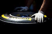 May 20-24, 2015: Monaco - Ferrari mechanic with a Pirelli tire