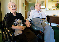 World War I Veteran Harry Landis, 107, at home in Sun City Center.  Landis is one of only four known surviving veterans of WWI.  Pictured, Eleanor smiles as her husband holds her hand.
