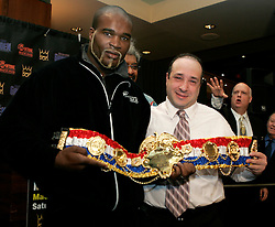 Ring Magazine Cruiserweight Champ Jean-Marc Mormeck receives his belt from Ring Managing Editor Joe Santoliquito at the presser announcing his upcoming fight.  Mormeck will meet O'Neill Bell at the Theater at Madison Square Garden on January 7, 2005.