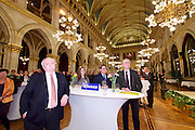 Vienna, Austria. Cocktail reception hosted by Mayor Michael Häupl at City Hall for international scientists and researchers living and working in Vienna.<br /> From l.: Dr. Michael Häupl, Mayor of Vienna; Prof. Katharine Sarikakis, Media Organisation and Governace, University of Vienna; Giulio Superti-Furga, Scientific Director of the CeMM Research Center for Molecular Medicine of the Austrian Academy of Science; Alexander van der Bellen, Commissioner for Universities and Research.