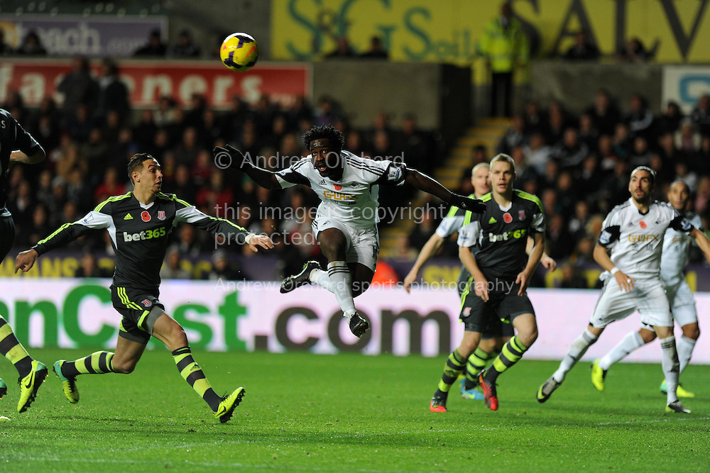 Swansea's Wilfried Bony © scores his sides 1st goal with a header to make it 1-2.  Barclays Premier league, Swansea city v Stoke city at the Liberty Stadium in Swansea, South Wales on Sunday 10th November 2013. pic by Andrew Orchard, Andrew Orchard sports photography,