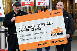 © Licensed to London News Pictures. 02/01/2014. London, UK. RMT General Secretary Bob Crow (L) and ASLEF General Secretary Mick Whelan are seen at a protest over today's (02/01/2014) 3.1% rail fare rise outside King's Cross Station in London this morning. The rail fare rise came in to force today as most across the country returned to work for the start of 2014. Photo credit: Matt Cetti-Roberts/LNP