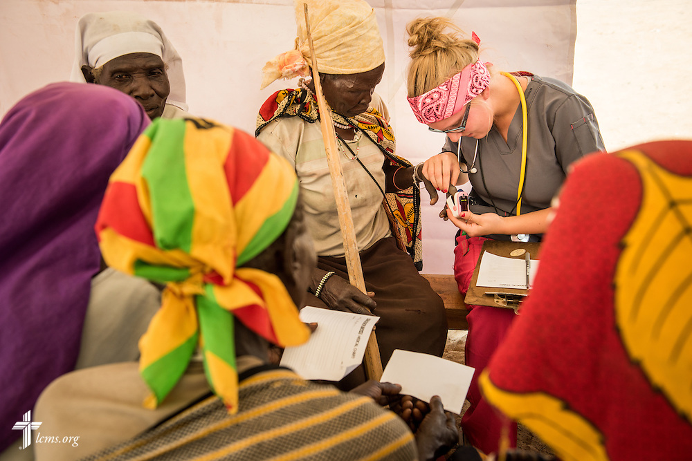 Sydney Kuempel takes vitals during the LCMS Mercy Medical Team clinic on Monday, June 20, 2016, in Nataparkakono, a village in Turkana, Kenya.  LCMS Communications/Erik M. Lunsford