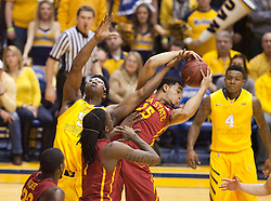 Iowa State Cyclones guard Naz Long grabs a rebound over West Virginia Mountaineers forward Devin Williams (5) during the first half at the WVU Coliseum.
