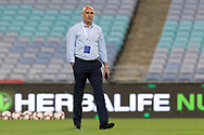 SYDNEY, AUSTRALIA - APRIL 27: Melbourne Victory coach Kevin Muscat on the phone before kick off at round 27 of the Hyundai A-League Soccer between Western Sydney Wanderers FC and Melbourne Victory on April 27, 2019 at ANZ Stadium in Sydney, Australia. (Photo by Speed Media/Icon Sportswire)