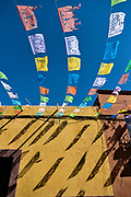 Paper fiesta banners against a clear blue sky decorate Quebrada Street in the historic center of San Miguel de Allende, Guanajuato, Mexico.