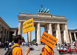 Tour guides offering services in Spanish  at Brandenburg Gate in Berlin, Germany