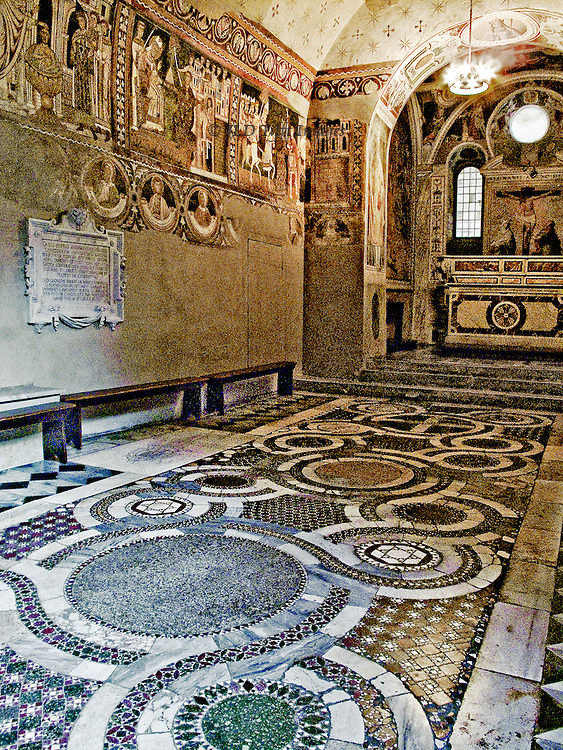 SS Quattro Coronati, chapel of St Sylvester, frescoes depicting  the legend of Emperor Constantine's cure from leprosy by Pope St. Sylvester and other miraculous events during the early pontiff's reign. They were completed and consecrated in 1246. Interior view of the chapel, showing floor inlaid Cosmati work, altar, and part of the wall paintings.