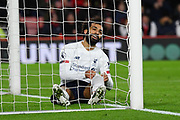 Mohamed Salah (11) of Liverpool sits in the goalmouth after missing a chance to score during the Premier League match between Bournemouth and Liverpool at the Vitality Stadium, Bournemouth, England on 7 December 2019.