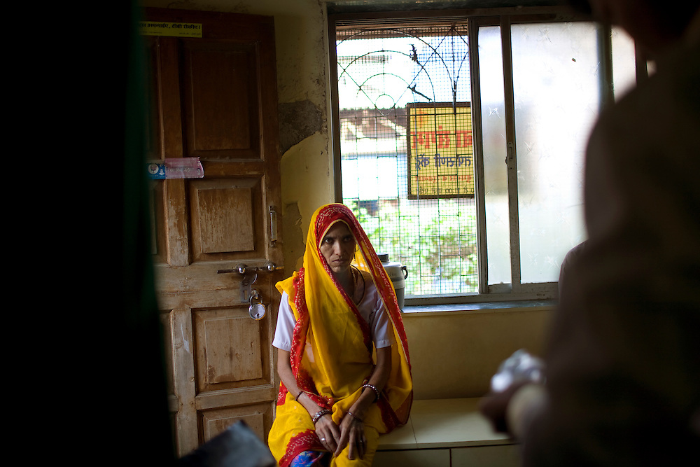 Premi Suvasiya waits to receive her medicine at the Thakkar Bappa DOTS Clinic.