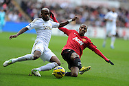 Swansea city's Dwight Tiendalli is tackled by Utd's Ashley Young. Barclays premier league, Swansea city v Manchester Utd at the Liberty stadium in Swansea, South Wales on Sunday 23rd Dec 2012. pic by Andrew Orchard, Andrew Orchard sports photography,