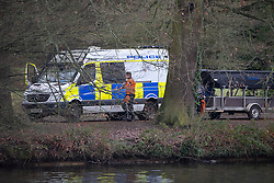 © Licensed to London News Pictures. 05/02/2019. Reading, UK. A police boat is parked next to Whiteknights Lake at Reading University campus in Berkshire after a body was found in the search for missing student Daniel Williams. Daniel has been missing for five days. Photo credit: Peter Macdiarmid/LNP