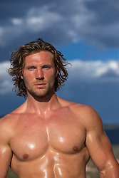 hot muscular man with long brown hair outdoors