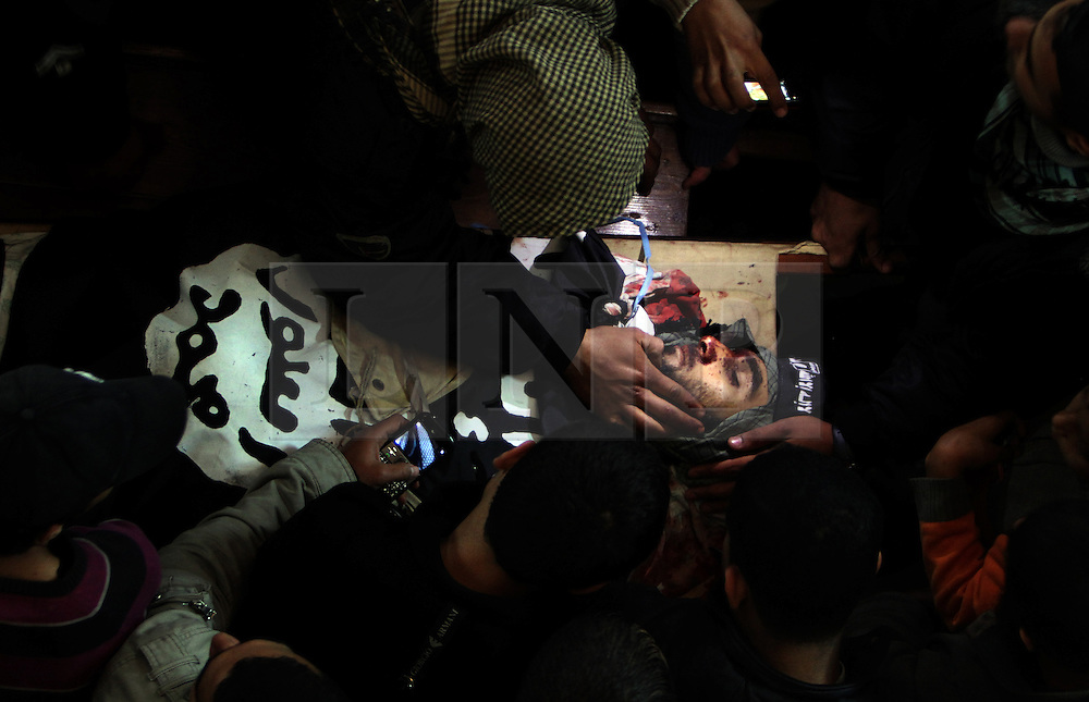 ©Licensed to London News Pictures. 30/12/2011, Gaza. .The body of islamic militant Momen Abu Daf is surrounded by mourners during his funeral at Al-Omari mosque in central Gaza City 30 December 2011. Moumen was killed and several others were wounded in an Israeli air strike on the Gaza Strip.. Photo Credit: Ali Jadallah /PNC/LNP