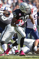 02 October 2011: Runningback (20) Darren McFadden of the Oakland Raiders runs the ball against the New England Patriots during the first half of the Patriots 31-19 victory against the Raiders in an NFL football game at O.co Stadium in Oakland, CA.