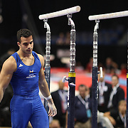 Danell Leyva, Homestead, Florida, falls from the Parallel bars during his routine during the first day of Senior Men Competition at The 2013 P&G Gymnastics Championships, USA Gymnastics' National Championships at the XL, Centre, Hartford, Connecticut, USA. 16th August 2013. Photo Tim Clayton