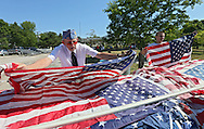 Steven Shaffer (from left) and Cody Richards, 17, both of Springville, sort flags before they are burned at the Springville Fire Department in Springville on Saturday, June 9, 2012. The flag disposal ceremony was organized by the Springville American Legion Post. (Stephen Mally/Freelance)