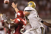 Vanderbilt Commordores tight end Dustin Dunning goes up for a pass over Arkansas Razorback defensive end Desmond Sims during a 28 to 24 Commodores win on September 10, 2005 at Donald W. Reynolds Stadium in Fayetteville, Arkansas..Mandatory Credit: Wesley Hitt/Icon SMI